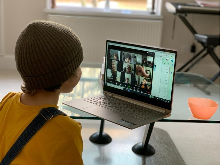 Image: A school kid socializes with peers online following school closures due the spread of the coronavirus disease (COVID-19) outbreak, in London