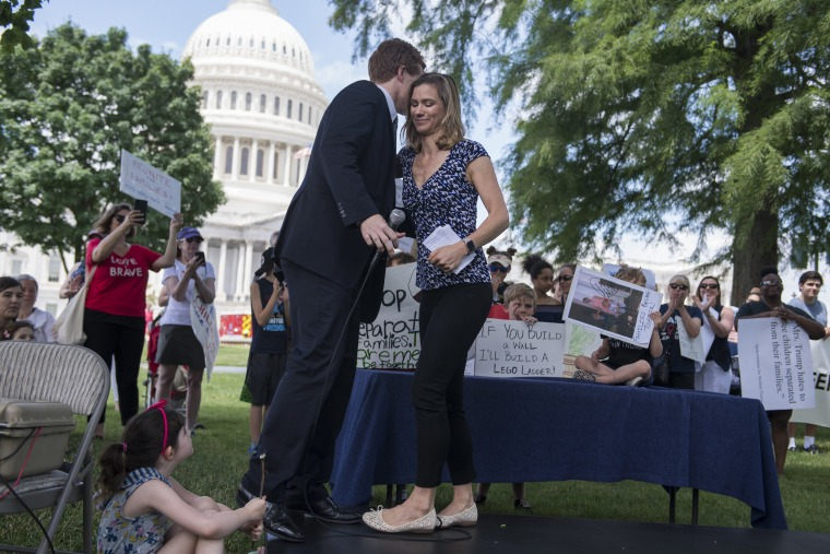 Maeve Kennedy McKean greets Rep. Joe Kennedy, D-Mass., during a rally on the East Front lawn of the Capitol to condemn the separation and detention of families at the border of the U.S. and Mexico on June 21, 2018.