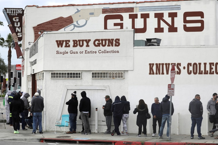 Image: FILE PHOTO: People wait in line outside to buy supplies at the Martin B. Retting, Inc. gun store amid fears of the global growth of coronavirus cases, in Culver City
