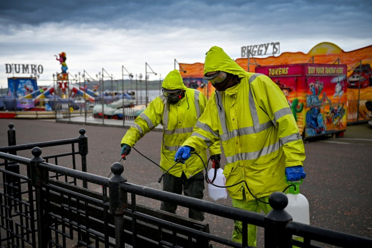 Image: Cleaners disinfect surfaces in Largs, Scotland, on April 4, 2020.