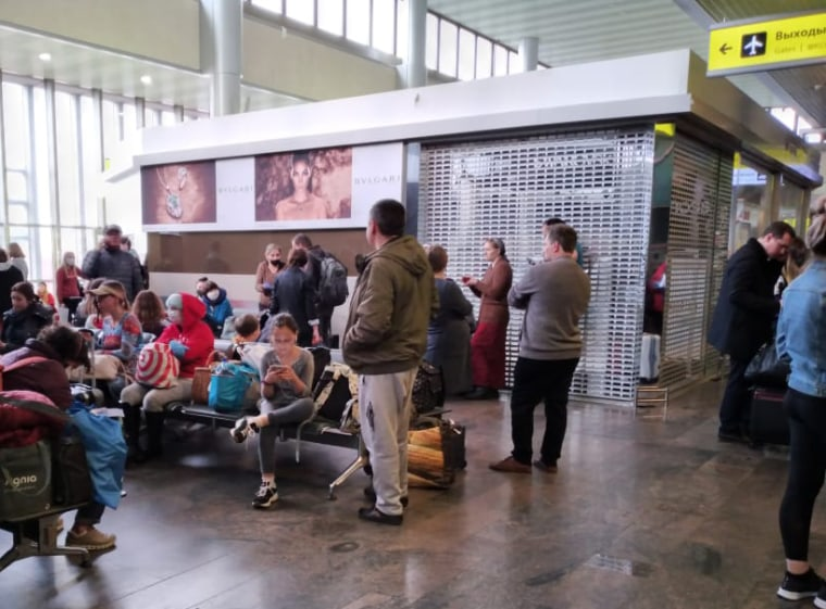 A group of passengers waits in Moscow's Sheremetyevo International Airport after their flight was canceled.