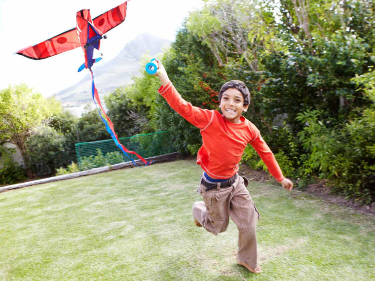 Young boy plays with a kite