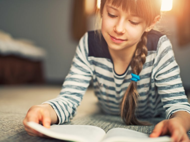 Young girl reads a book.