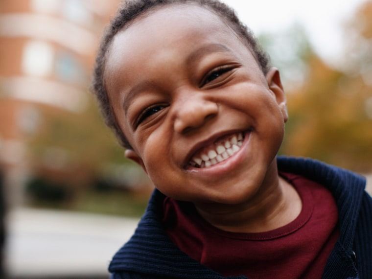 Young child smiling.