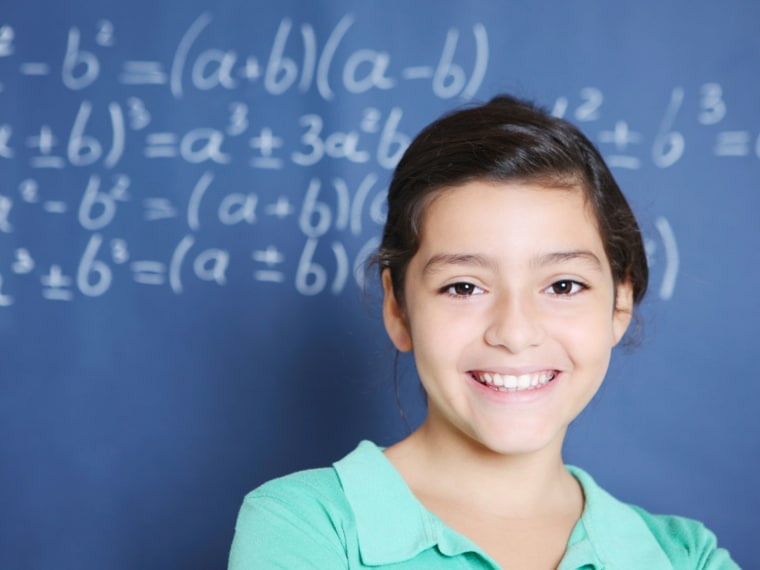 Girl standing in front of math equations on chalkboard