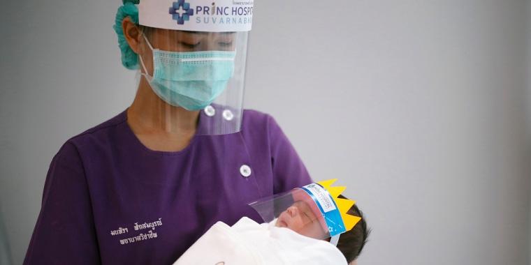 Newborn baby wear face shield to prevent the COVID-19 coronavirus pandemic, Samut Prakan, Thailand - 08 Apr 2020