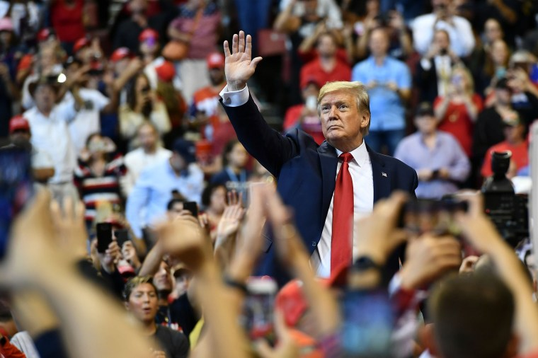"""Image: President Donald Trump waves to supporters during a \""""Keep America Great\"""" campaign rally in Sunrise"""