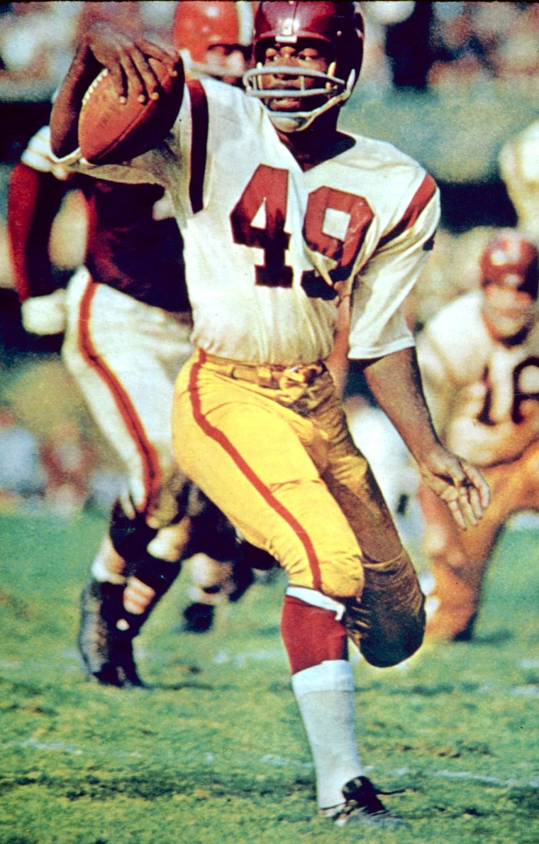 Image: Halfback Bobby Mitchell (49) of the Washington Redskins in the open field during a 14-37 loss to the Cleveland Browns on Sept. 15, 1963