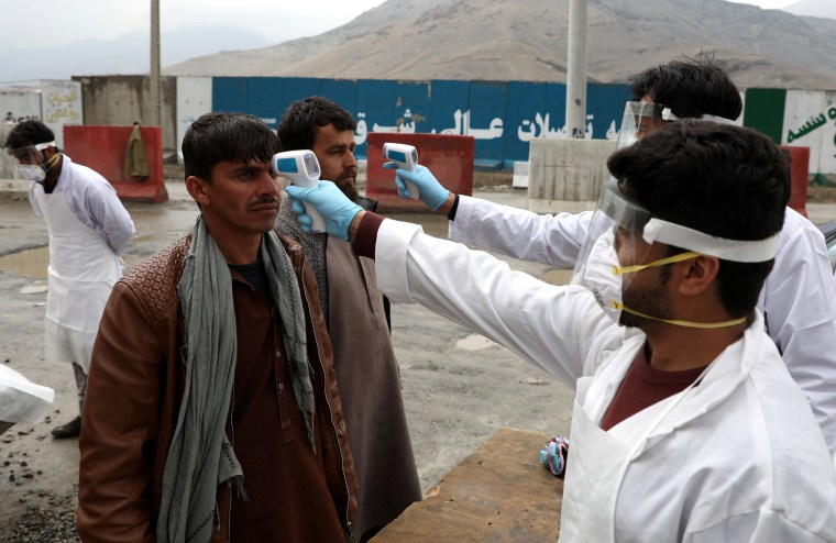Image: Medical workers check temperatures