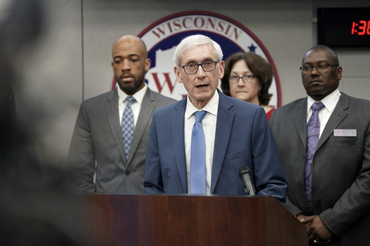 Gov. Tony Evers declares a public health emergency in response to a growing number of cases of COVID-19, in Madison, Wis., on March 12, 2020.