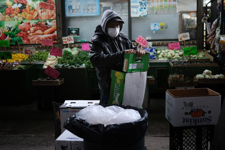 Image: Grocery store worker in Brooklyn
