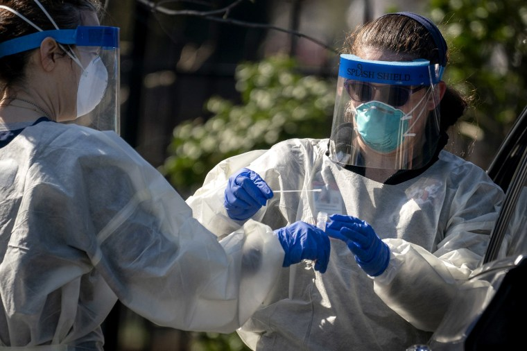 Image: Medical workers administer a coronavirus test at Trinity University in Washington, D.C., on April 2, 2020.