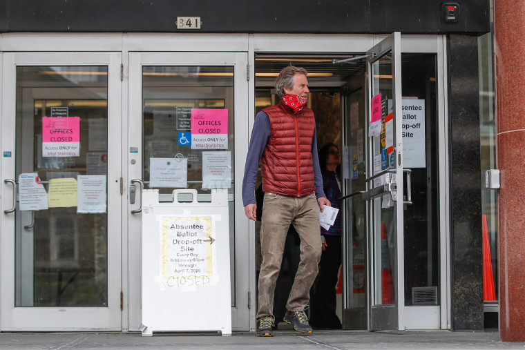 Image: A man leaves the Frank P. Zeidler Municipal Building after not being able to cast his ballot at the already closed drop-off site in Milwaukee, Wisconsin