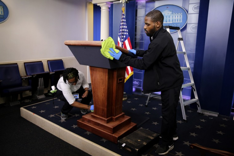 Image: Workers clean the podium before a coronavirus task force briefing at the White House on April 1, 2020.