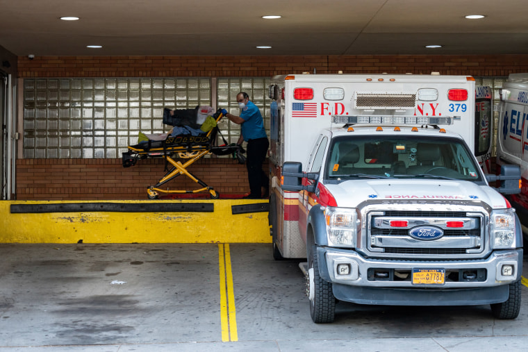 Image: A person is transported from an ambulance to the emergency room at Wyckoff Heights Medical Center on April 7, 2020 in New York.