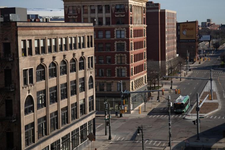 A bus travels along an empty street in Detroit