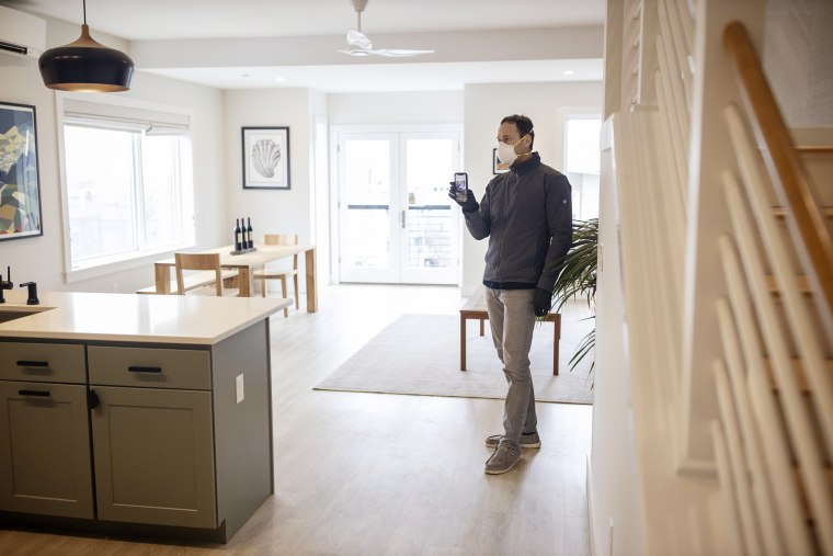 Image: Tom Landry, broker and owner of Benchmark Real Estate, does a Facebook Live tour of a condo for sale in the East End of Portland