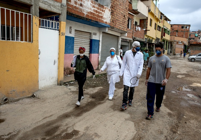 Image: Doctors and Nurses Hired by G10 Go Door to Door to See Patients in Paraisopolis Amidst the Coronavirus (COVID - 19) Pandemic