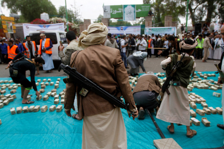 Image: Houthi supporters carry weapons during a gathering in Sanaa