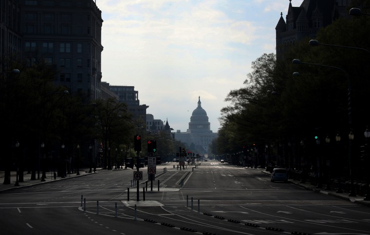 Image: An empty Washington street looking towards the Capitol on April 7, 2020.