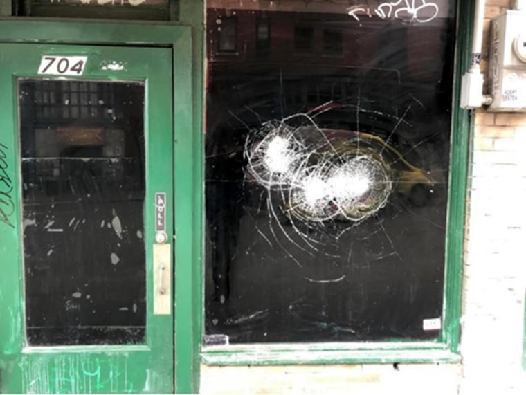 Image: Eric Chan found broken windows at his family's Seattle restaurant in late March. At the moment, the restaurant doesn't have the money to make the necessary repairs.