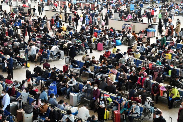 Image: Travellers are seen inside Hankou Railway Station in Wuhan