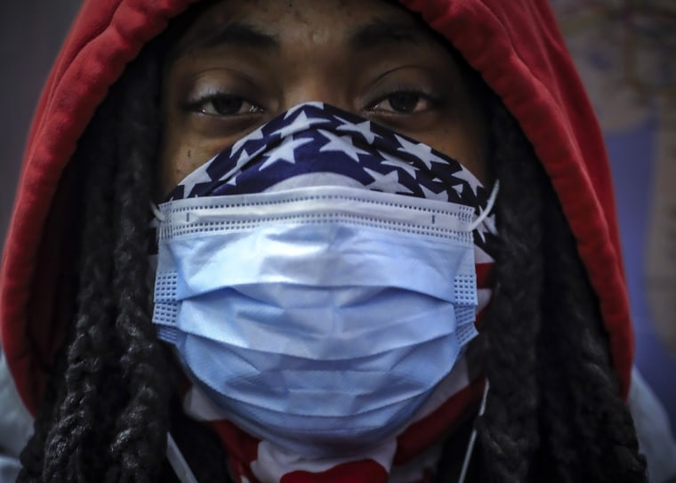 Image: Closeup subway rider mask