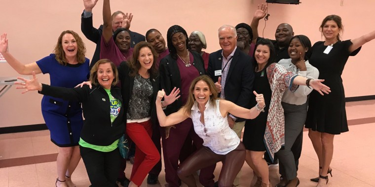 CEO of GENYOUth Alexis Glick with school educators and frontline school food service workers from Miami-Dade County Public Schools.