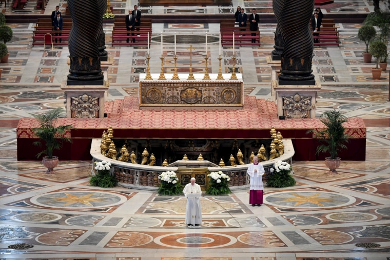 Image: Pope Francis reads his Easter message during mass at St. Peter's Basilica on April 12, 2020.