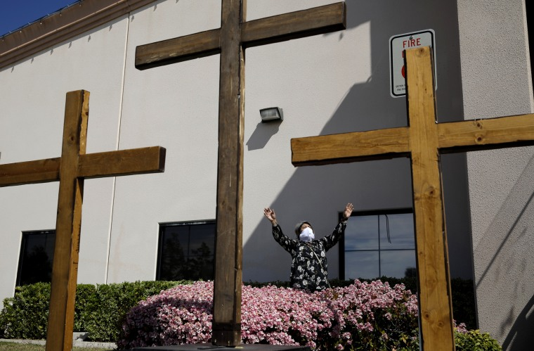 Image: Norma Urrabazo prays at an Easter drive-in service at the International Church of Las Vegas on April 12, 2020.