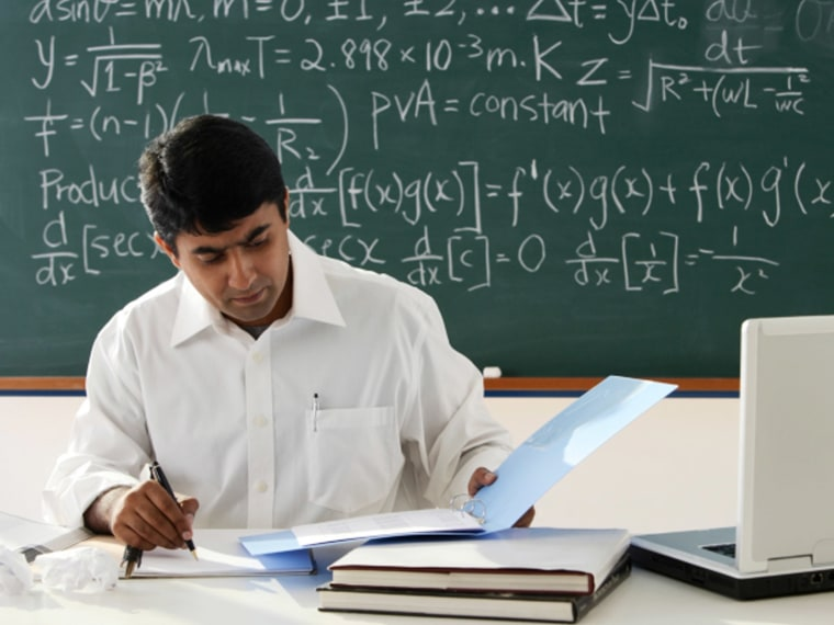 A teacher grades math assignments.
