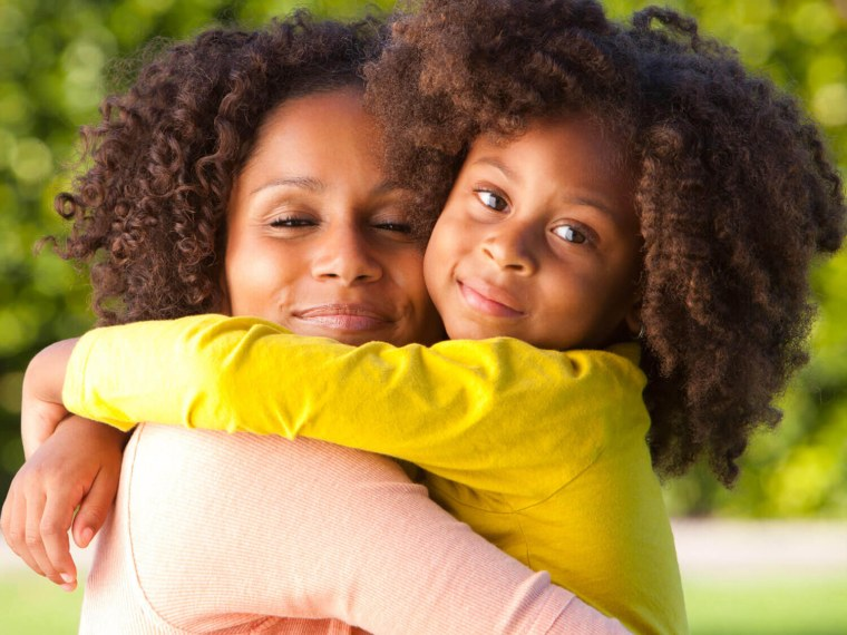 Young girl hugs her mother