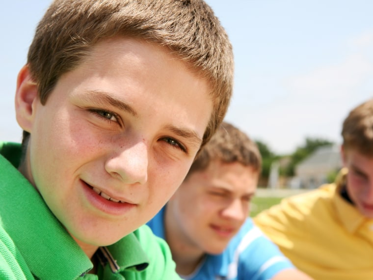 Smiling middle school boy