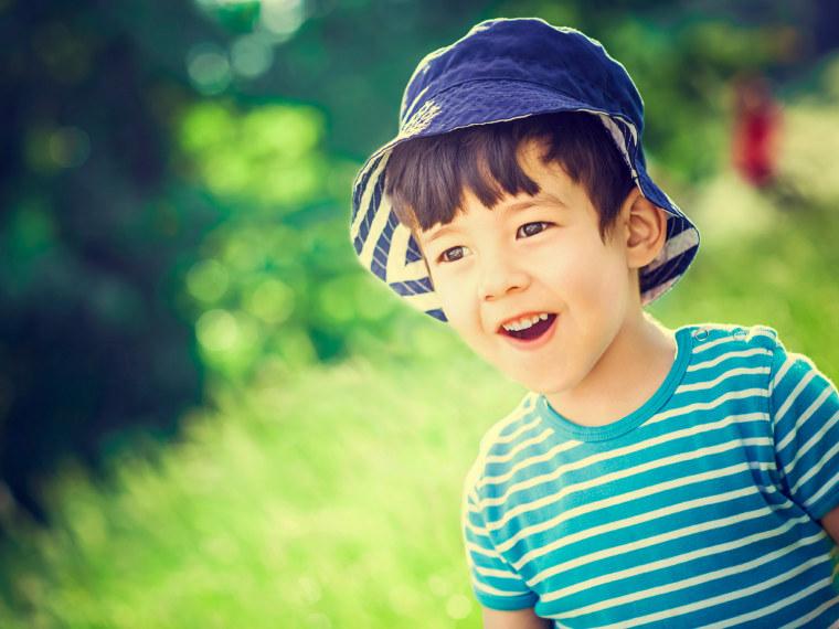 Little boy in a bucket hat