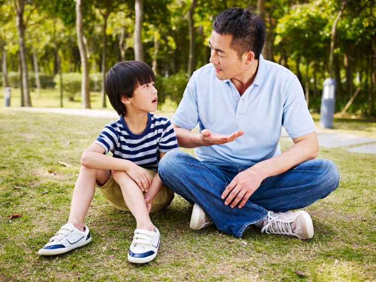 Father and son talk outside