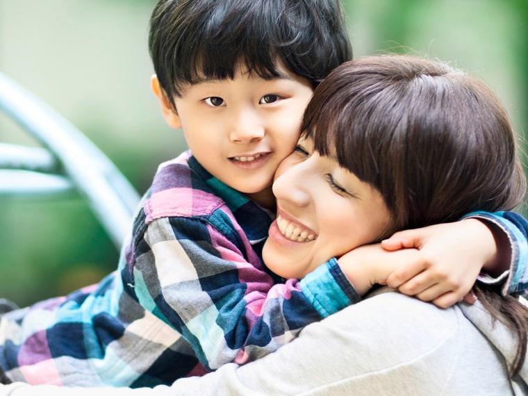 Mother-son hug