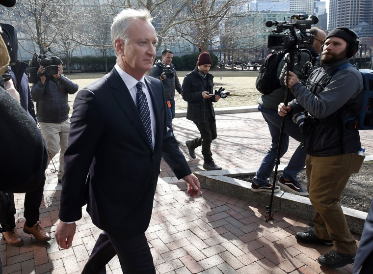 Image: Toby MacFarlane departs federal court in Boston after facing charges in a college admissions bribery scandal on April 3, 2019.