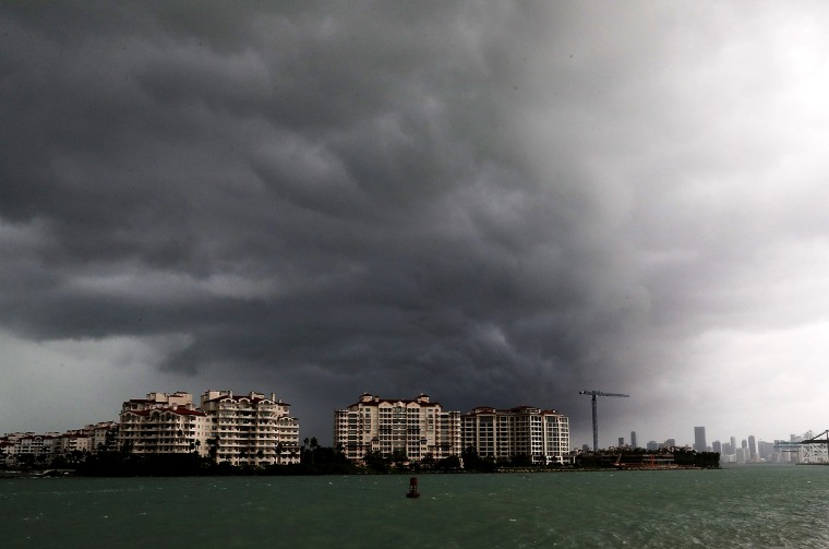 Image: Storm clouds approach Fisher Island off the coast of Miami Beach in 2017.