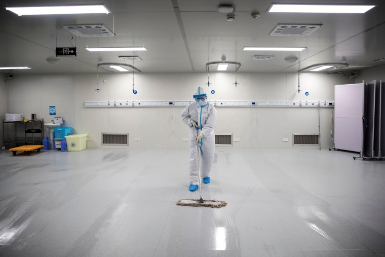 Image: A staff member cleans the floor after the last patients were discharged from Leishenshan Hospital, originally built to treat people infected with COVID-19, in Wuhan on Tuesday.