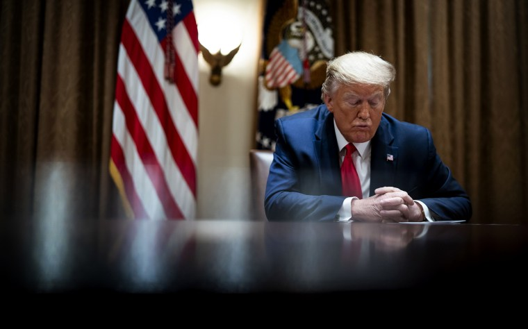 Image: President Donald Trump listens during a meeting in the Cabinet Room at the White House on April 14, 2020.