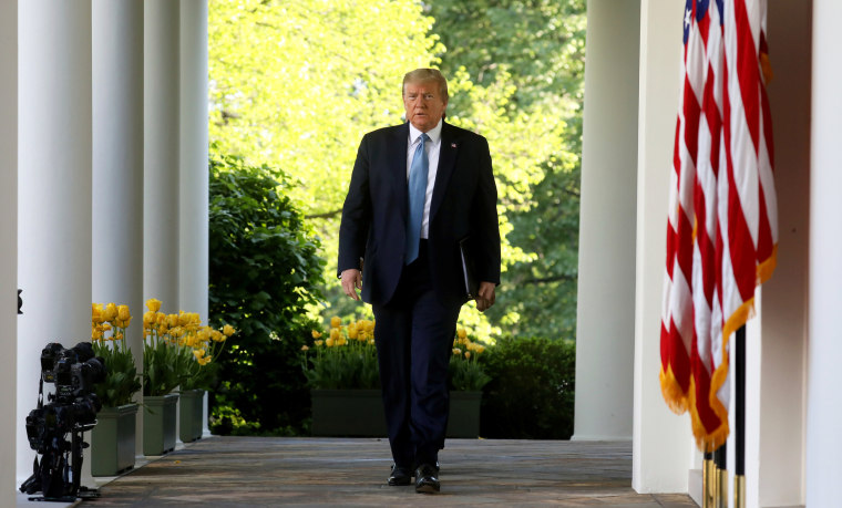 Image: President Donald Trump arrives for the daily coronavirus task force briefing in the Rose Garden
