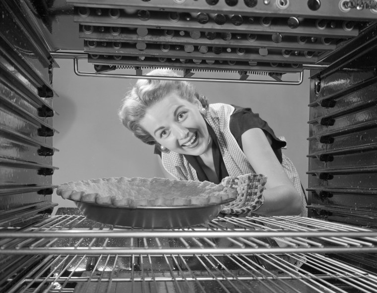 Image: Woman Looking at Pie in Oven