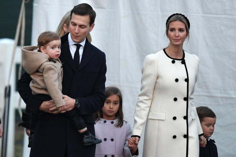 Image: Senior Advisor to the President, Jared Kushner, and Ivanka Trump, walk with their children at the Ellipse in President's Park near the White House