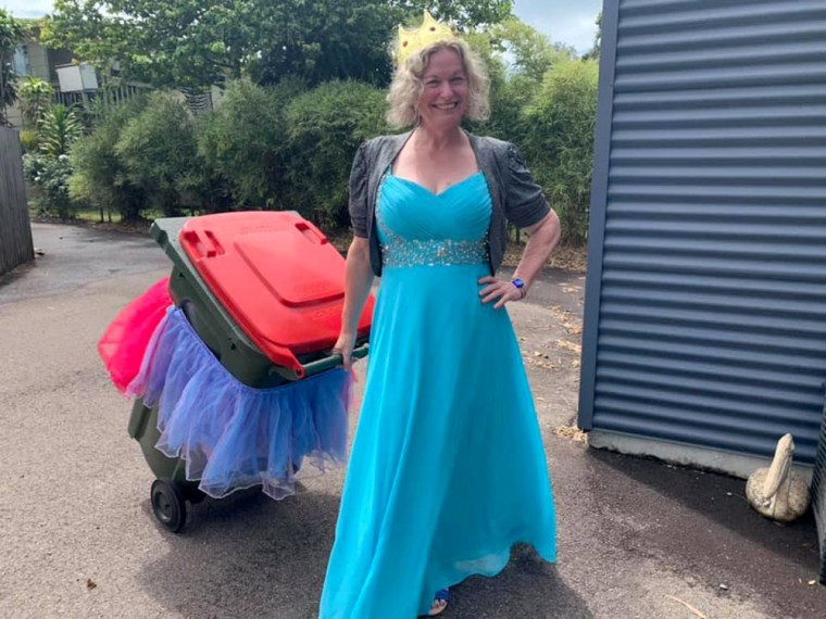 Image: Danielle Askew, 47, says she has a backlog of 18,000 submissions from people who are dressing up to take out the trash.