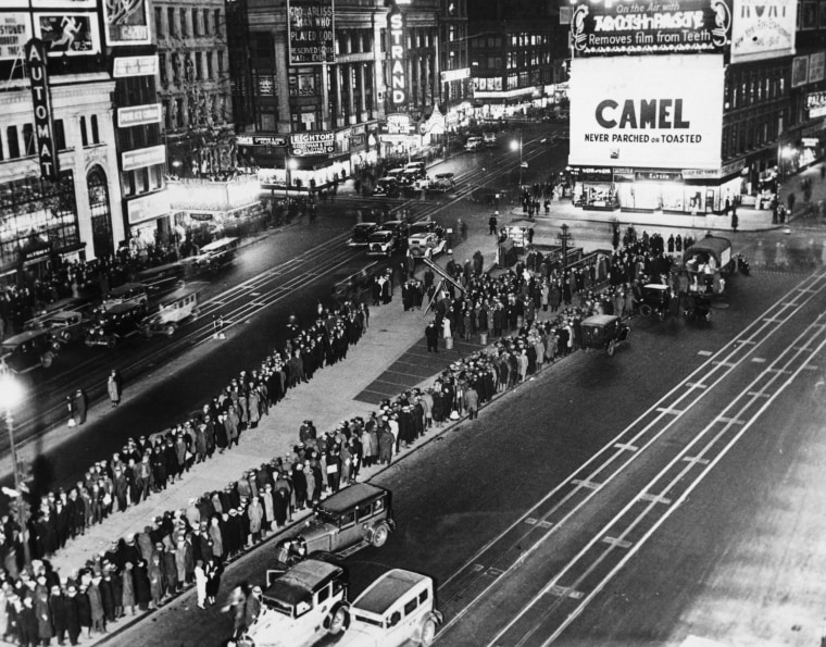 Unemployed people wait in line for rations in Times Square during the Great Depression