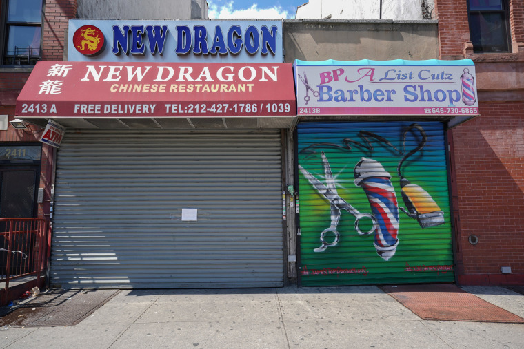 Image: A Chinese restaurant and barber shop in Harlem are closed,