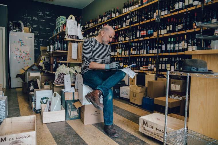 Image: Mark Schwartz prepares orders for delivery at his liquor store, Little Mo Wine and Spirits in Brooklyn on April 16, 2020.