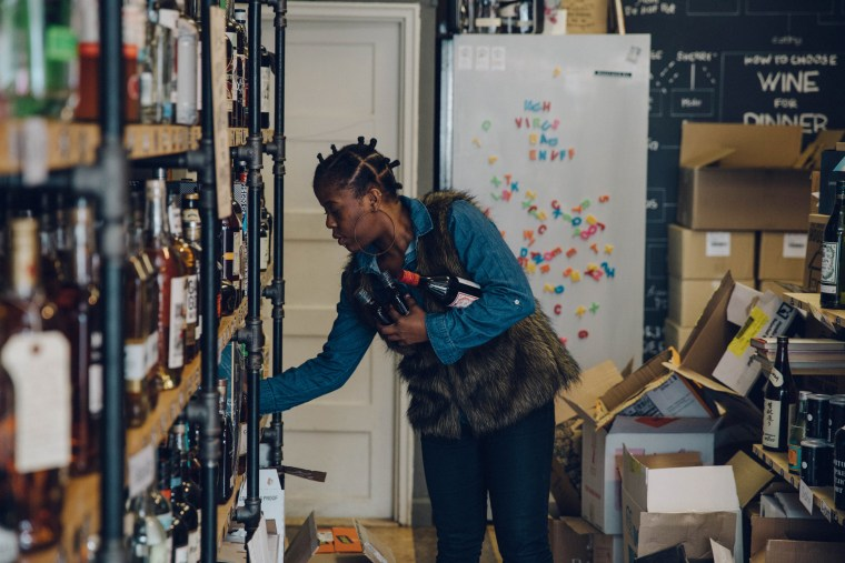 Image: Deanna Rowe prepares orders at Mark Schwartz's liquor store, Little Mo Wine and Spirits in Brooklyn