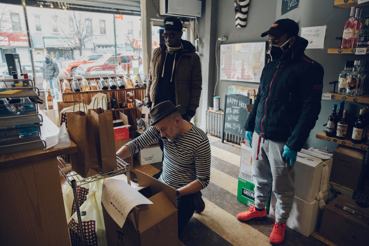 Image: Mark Schwartz prepares orders for delivery in Brooklyn, N.Y., on April 16, 2020.