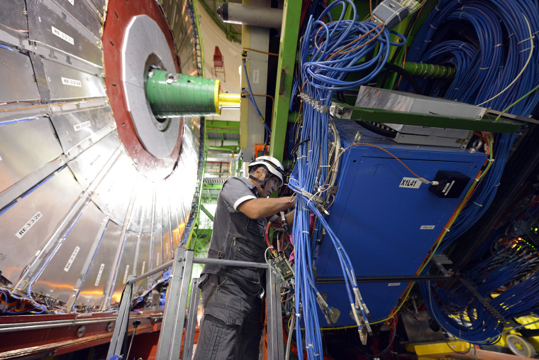 Image: A technician works on the CMS detector, part of the CERN LHC experiment